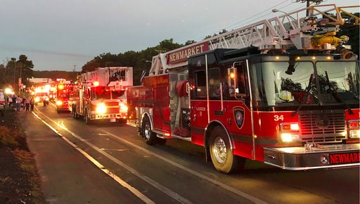 (AP Photo/Phil Marcelo). Multiple fire trucks from surrounding communities arrive Thursday, Sept. 13, 2018, in Lawrence, Mass., responding to a series of gas explosions and fires triggered by a problem with a gas line that feeds homes in several commun...