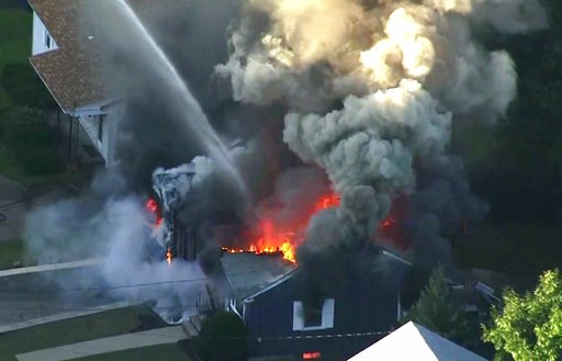 (WCVB via AP). In this image take from video provided by WCVB in Boston, flames consume the roof of a home in Lawrence, Mass, a suburb of Boston, Thursday, Sept. 13, 2018. Emergency crews are responding to what they believe is a series of gas explosion...