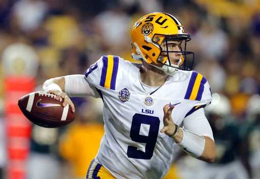(AP Photo/Gerald Herbert, file). FILE - In this Sept. 8, 2018 file photo LSU quarterback Joe Burrow (9) scrambles as he looks for a receiver in the second half of an NCAA college football game against Southeastern Louisiana in Baton Rouge, La. The stag...