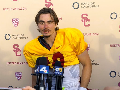 (AP Photo/Greg Beacham, File). File - In this Aug. 28, 2018, file photo, Southern California quarterback J.T. Daniels speaks to reporters following his first NCAA college football practice after winning the Trojans' starting job in Los Angeles. There i...