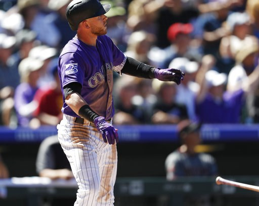 (AP Photo/David Zalubowski). Colorado Rockies' Trevor Story follows the flight of his two-home run off Arizona Diamondbacks starting pitcher Matt Koch in the third inning of a baseball game Thursday, Sept. 13, 2018, in Denver.