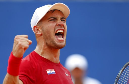 (AP Photo/Darko Bandic). Borna Coric of Croatia celebrates after winning the second set as he plays against Steve Johnson of the United States during a Davis Cup semifinal singles tennis match between Croatia and the United States in Zadar, Croatia, Fr...
