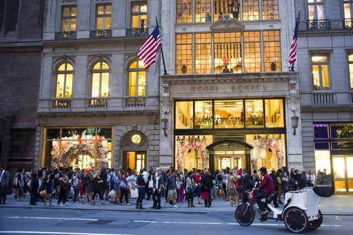 (AP Photo/Charles Sykes, File). FILE- In this Sept. 8, 2011, file photo shoppers gather outside the Henri Bendel store on Fifth Avenue during Fashion's Night Out in New York. Henri Bendel, known for its brown and white striped shopping bags, is closing...
