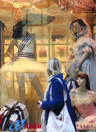 (AP Photo/Mark Lennihan, File). FILE- In this Nov. 23, 2010, file photo a woman looks at a Henri Bendel holiday window display in New York. Henri Bendel, known for its brown and white striped shopping bags, is closing in the new year. The luxury retail...