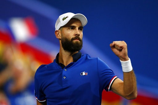 (AP Photo/Michel Spingler). France's Benoit Paire reacts as he plays Spain's Pablo Carreno Busta during the Davis Cup semifinals France against Spain, Friday, Sept.14, 2018 in Lille, northern France.