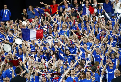 (AP Photo/Michel Spingler). Supporters of the French tennis team wave before the Davis Cup France against Spain, Friday, Sept.14, 2018 in Lille, northern France.