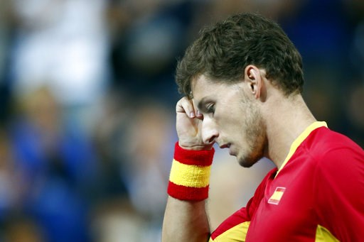(AP Photo/Michel Spingler). Spain's Pablo Carreno Busta reacts as he plays France's Benoit Paire during the Davis Cup semifinals France against Spain, Friday, Sept.14, 2018 in Lille, northern France.