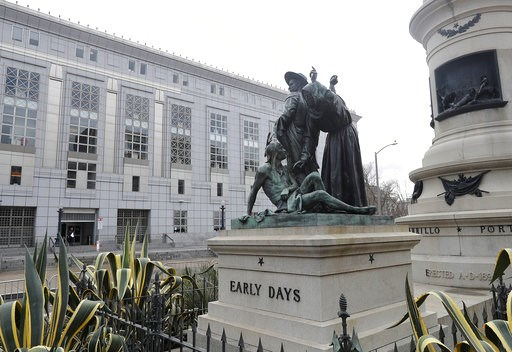 (AP Photo/Jeff Chiu, File). FILE - This March 2, 2018 file photo shows a statue that depicts a Native American at the feet of a Spanish cowboy and Catholic missionary in San Francisco. A San Francisco board has decided to remove the 19th-century statue...
