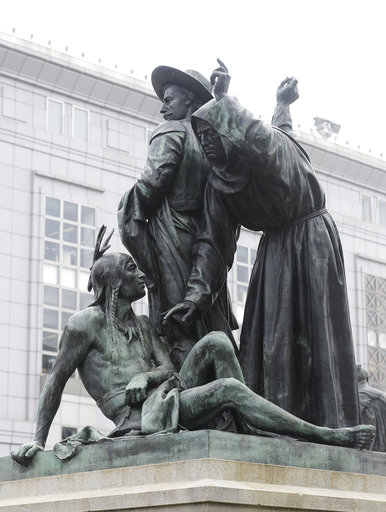 (AP Photo/Jeff Chiu, File). FILE - This Friday, March 2, 2018 file photo shows a statue that depicts a Native American at the feet of a Spanish cowboy and Catholic missionary in San Francisco. A San Francisco board has decided to remove the 19th-centur...