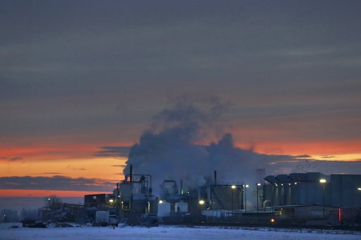 (AP Photo/Brennan Linsley, File). FILE - In this Jan. 11, 2016 file photo, dawn approaches over the meat processing plant owned and run by Cargill Meat Solutions, in Fort Morgan, a small town on the eastern plains of Colorado. The U.S. Equal Employment...