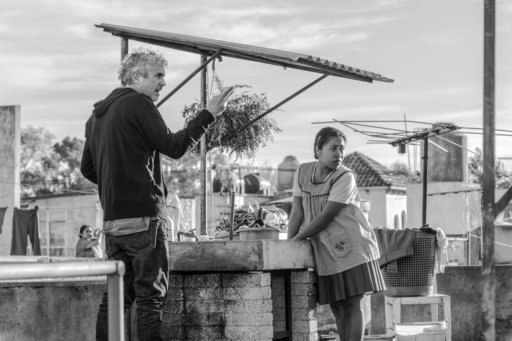 "(Carlos Somonte/Netflix via AP). This image released by Netflix shows filmmaker Alfonso Cuaron on the set of ""Roma."" The Mexican film academy announced Friday that it has chosen ""Roma"", by Academy Award-winner Alfonso Cuaron, as its bid for a best fore..."