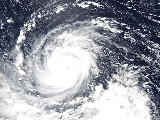 (Lauren Dauphin/NASA Earth Observatory via AP). In this Wednesday, Sept. 12, 2018, NASA satellite image, Super Typhoon Mangkhut churns west towards the Philippines. Philippine officials have begun evacuating thousands of people in the path of the most ...