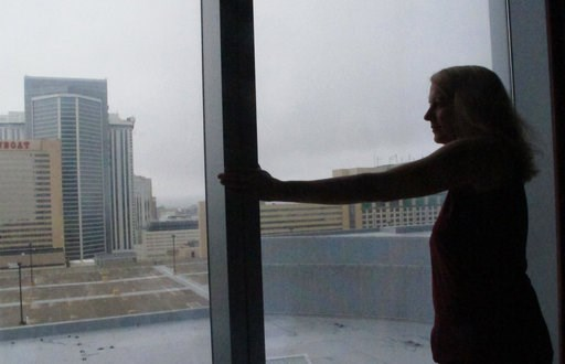 (AP Photo/Wayne Parry). Mimi Razzi of Pawleys Island, S.C. looks out the window from her room at the Ocean Resort Casino in Atlantic City N.J. on Friday Sept. 14, 2018. Razzi was one of hundreds of people fleeing Hurricane Florence who accepted the cas...