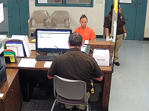 (Kaufman County Sheriff's Office Jail via AP). This photo from video released Thursday, Sept. 13, 2018, by the Kaufman County Sheriff's Office in Kaufman, Texas, shows Dallas police Officer Amber Guyger getting booked after turning herself in Sunday, S...