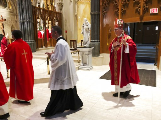 (AP Photo/Jennifer McDermott). Providence diocese Bishop Thomas Tobin, right, enters the during the processional at the Cathedral of Saints Peter and Paul in Providence, R.I., Friday, Sept. 14, 2018, for a day of prayer and penance he called for due to...