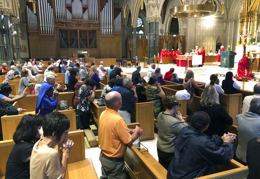 (AP Photo/Jennifer McDermott). Parishioners kneel as Providence diocese Bishop Thomas Tobin, right begins Mass at the Cathedral of Saints Peter and Paul in Providence, R.I., Friday, Sept. 14, 2018. Tobin called for a day of prayer and penance he called...