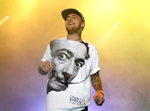 (Photo by Owen Sweeney/Invision/AP, File). FILE - In this July 13, 2013, file photo, Rapper Mac Miller performs on his Space Migration Tour at Festival Pier in Philadelphia. Ariana Grande has posted a tribute to her ex-boyfriend Mac Miller a week after...