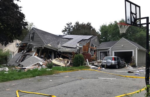 (Carl Russo/The Eagle-Tribune via AP). ADDS IDENITY OF VICTIM LEONEL RONDON-  A collapsed home and car sit damaged on Chickering Street in Lawrence, Mass., Thursday, Sept. 13, 2018, after a series of gas explosions in several communities north of Bosto...