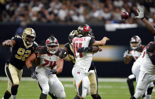 (AP Photo/Bill Feig). New Orleans Saints defensive tackle David Onyemata commits a late hit on Tampa Bay Buccaneers quarterback Ryan Fitzpatrick (14) which resulted in a penalty and a scuffle in the second half of an NFL football game in New Orleans, S...