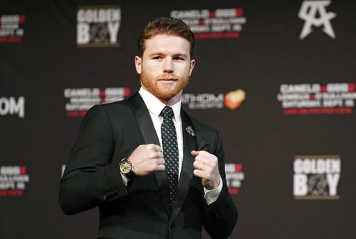 (AP Photo/John Locher). Canelo Alvarez poses during a news conference Wednesday, Sept. 12, 2018, in Las Vegas. Alvarez is scheduled to fight Gennady Golovkin in a title bout Saturday in Las Vegas.