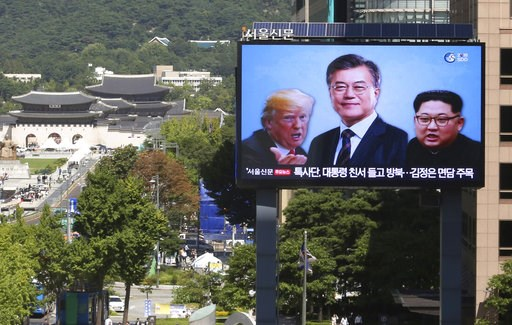 (AP Photo/Ahn Young-joon, File). FILE - In this Sept. 5, 2018, file photo, a TV screen shows images of North Korean leader Kim Jong Un, right, South Korean President Moon Jae-in, center, and U.S. President Donald Trump to advertise upcoming Seoul Defen...