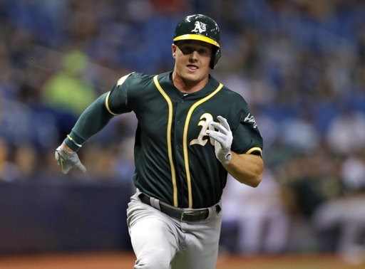 (AP Photo/Chris O'Meara). Oakland Athletics' Matt Chapman races home to score on an RBI single by Matt Olson off Tampa Bay Rays pitcher Ryan Yarbrough during the fourth inning of a baseball game Friday, Sept. 14, 2018, in St. Petersburg, Fla.