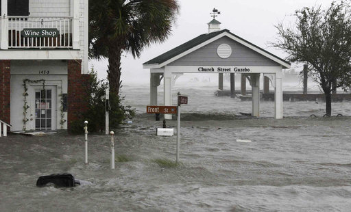 (AP Photo/Tom Copeland). High winds and water surround buildings as Hurricane Florence hits Front Street in downtown Swansboro N.C., Friday, Sept. 14, 2018.