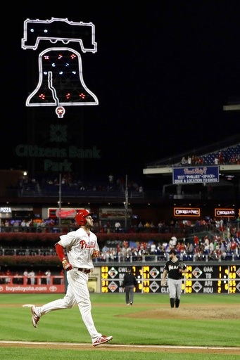 (AP Photo/Matt Slocum). Philadelphia Phillies' Mitch Walding, left, rounds the bases after hitting a two-run home run off Miami Marlins relief pitcher Bryan Holaday during the eighth inning of a baseball game, Friday, Sept. 14, 2018, in Philadelphia.
