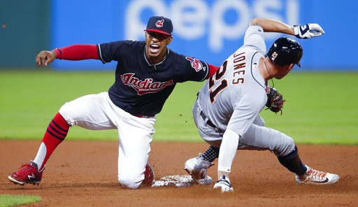 (AP Photo/Ron Schwane). Detroit Tigers' JaCoby Jones, right, steals second base as Cleveland Indians' Francisco Lindor attempts a tag during the eighth inning of a baseball game, Friday, Sept. 14, 2018, in Cleveland.
