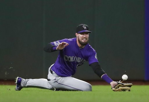 (AP Photo/Tony Avelar). Colorado Rockies left fielder David Dahl cannot make the catch on a fly ball by San Francisco Giants' Joe Panik during the fourth inning of a baseball game in San Francisco, Friday, Sept. 14, 2018.