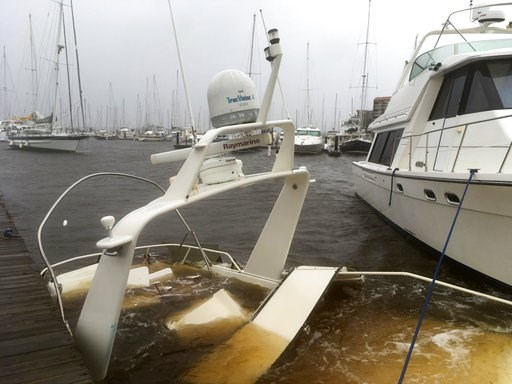 (AP Photo/Allen G. Breed). The mast of a sunken boat sits at a dock at the Grand View Marina in New Bern, N.C., on Friday, Sept. 14, 2018. Winds and rains from Hurricane Florence caused the Neuse River to swell, swamping the coastal city.