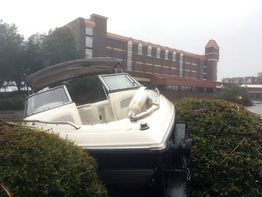 (AP Photo/Allen G. Breed). A speed boat sits wedged in bushes in the parking lot of a waterfront hotel in New Bern, N.C., on Friday, Sept. 14, 2018. Winds and rains from Hurricane Florence caused the Neuse River to swell, swamping the coastal city.