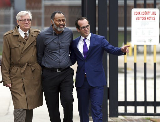 (Terrence Antonio James/Chicago Tribune via AP). FILE - In this Friday, June 22, 2018 file photo, Jackie Wilson, flanked by his attorneys G. Flint Taylor, left, and Elliot Slosar, leaves the Cook County Jail in Chicago, after a judge issued a finding t...