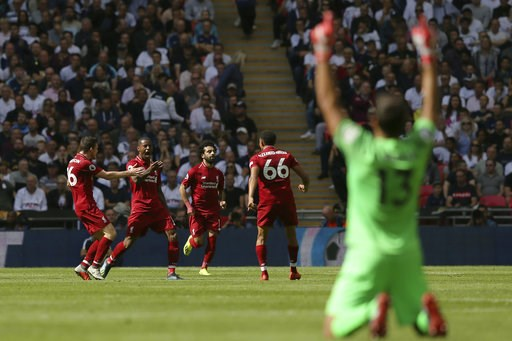 (AP Photo/Tim Ireland). Liverpool's Georginio Wijnaldum, 2nd from left, reacts as he celebrates with team members after scoring his side opening goal during the English Premier League soccer match between Tottenham Hotspur and Liverpool at Wembley Stad...