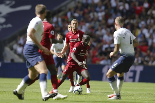 (AP Photo/Tim Ireland). Liverpool's Sadio Mané, center, vies the ball during the English Premier League soccer match between Tottenham Hotspur and Liverpool at Wembley Stadium in London, Saturday Sept. 15, 2018.