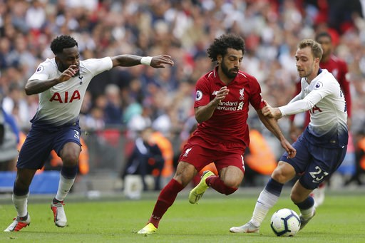 (AP Photo/Tim Ireland). Liverpool's Mohamed Salad, center, vies the ball past Tottenham's Christian Eriksen, right during the English Premier League soccer match between Tottenham Hotspur and Liverpool at Wembley Stadium in London, Saturday Sept. 15, 2...