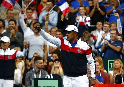 (AP Photo/Michel Spingler). French team captain Yannick Noah gestures during the Davis Cup semifinals double match against Spain in Lille, northern France, Saturday, Sept.15, 2018.