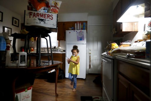 (AP Photo/David Goldman). Ahblyssyn Lewis, 4, stands in the kitchen of her home as food and other items are placed high off the floor, in Lumberton, N.C., Friday, Sept. 14, 2018. Two years after Hurricane Matthew brought devastating floods, the neighbo...