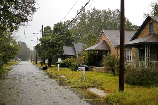(AP Photo/David Goldman). Homes stand vacant as Hurricane Florence threatens flooding to the neighborhood in Lumberton, N.C., Friday, Sept. 14, 2018. The rural town, battered by the collapse of its blue-collar economy and then by Hurricane Matthew, mig...