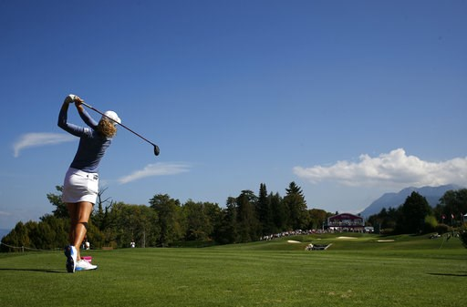 (AP Photo/Francois Mori). Amy Olson of the U.S. tees off to the 5th hole during the third round of the Evian Championship women's golf tournament in Evian, eastern France, Saturday, Sept. 15, 2018.