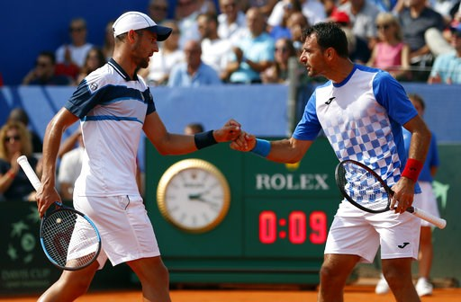 (AP Photo/Darko Bandic). Croatia's Ivan Dodig, right and Mate Pavic play their Davis Cup semifinal double match against Mike Bryan and Ryan Harrison of the United States, in Zadar, Croatia, Saturday, Sept. 15, 2018.