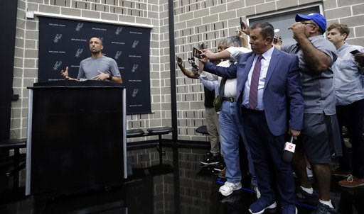 (AP Photo/Eric Gay). Former San Antonio Spurs guard Manu Ginobili, left, talks to the media at the NBA basketball team's practice facility, Saturday, Sept. 15, 2018, in San Antonio. Ginobili recently retired at age 41 after 16 seasons with the Spurs an...