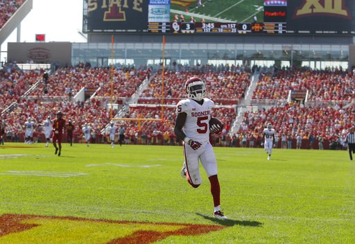 (AP Photo/Matthew Putney). Oklahoma wide receiver Marquise Brown runs in for a touchdown during the first half of an NCAA college football game against Iowa State, Saturday, Sept. 15, 2018, in Ames, Iowa.