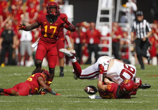(AP Photo/Matthew Putney). Iowa State defensive back Greg Eisworth, bottom right, tackles Oklahoma tight end Grant Calcaterra, top, right, to force a fumble and a turnover during the first half of an NCAA college football game, Saturday, Sept. 15, 2018...
