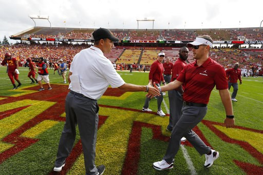 (AP Photo/Matthew Putney). Iowa State head coach Matt Campbell, left, meets with Oklahoma head coach Lincoln Riley, right, before an NCAA college football game, Saturday, Sept. 15, 2018, in Ames, Iowa.