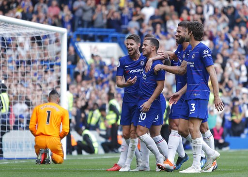 (AP Photo/Alastair Grant). Chelsea's Eden Hazard, second left celebrates after scoring from the penalty spot for his third goal of the game during their English Premier League soccer match between Chelsea and Cardiff City at Stamford Bridge stadium in ...