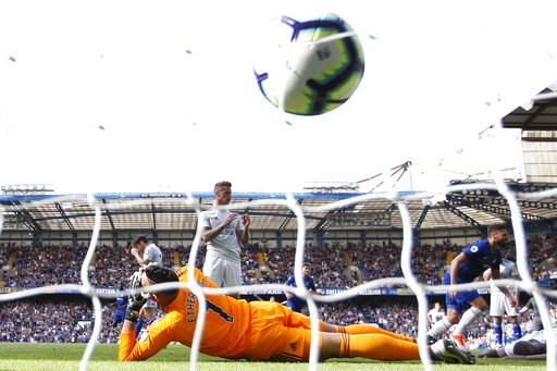 (AP Photo/Alastair Grant). Cardiff City's goalkeeper Neil Etheridge, foreground, and teammate Harry Arter, rear left, grab their head, with Joe Bennett reacting, center rear, after Chelsea's Eden Hazard scored his second goal during their English Premi...