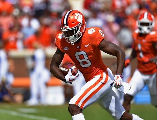 (AP Photo/Richard Shiro). Clemson's Justyn Ross breaks away for a touchdown after a reception in the first half of an NCAA college football game against Georgia Southern, Saturday, Sept. 15, 2018, in Clemson, S.C.