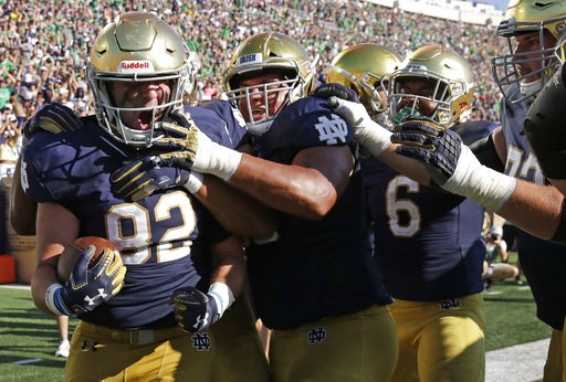 (AP Photo/Nam Y. Huh). Notre Dame tight end Nic Weishar, left, celebrates with teammates after catching a touchdown pass against Vanderbilt during the second half of an NCAA college football game in South Bend, Ind., Saturday, Sept. 15, 2018. Notre Dam...