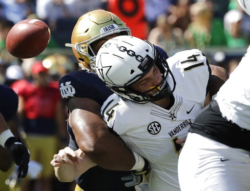 (AP Photo/Nam Y. Huh). Vanderbilt quarterback Kyle Shurmur (14) is sacked by Notre Dame defensive line Jerry Tilery during the first half of an NCAA college football game in South Bend, Ind., Saturday, Sept. 15, 2018.